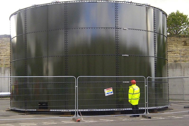 Agrivert employee admiring sewage treatment plant tank that we built